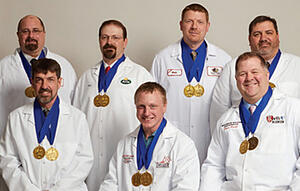 Wisconsin Master Cheesemakers class of 2018 wearing their medals of achievement.